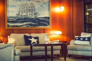 Ein Bett oder Betten in einem Zimmer der Unterkunft Hotel Barken Viking