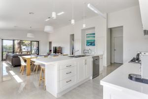 A kitchen or kitchenette at Diamond Bay Beach House: brand new