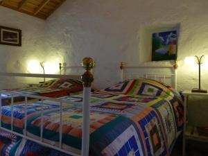 Uma cama ou camas num quarto em Quinta do Espírito Santo