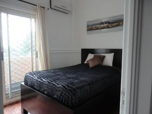 A bed or beds in a room at Residence Sanaga