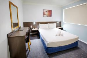 A bed or beds in a room at Hunts Hotel Liverpool