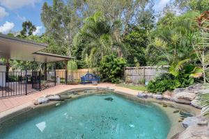The swimming pool at or near Kewarra Beach Hideaway - Three Bedroom House with Pool