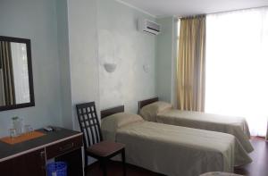 Кровать или кровати в номере Гостевой Дом Торнау