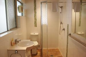 A bathroom at 1/33-35 Fletcher lane - A Beautiful Flat