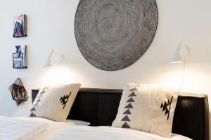 Postel nebo postele na pokoji v ubytování The BL42 Concept Apartment