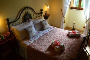 Letto o letti in una camera di B&B Palazzo La Loggia