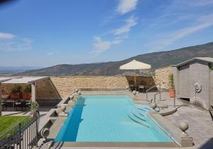 The swimming pool at or near Monastero Di Cortona Hotel & Spa