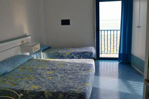 Postel nebo postele na pokoji v ubytování Hotel Playa e Mare Nostrum