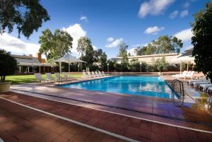 The swimming pool at or near Desert Gardens Hotel