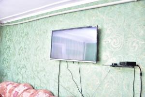 Телевизор и/или развлекательный центр в Hostel House