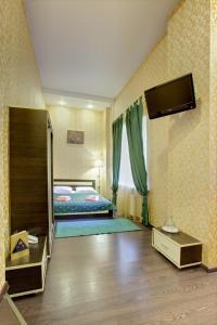 Кровать или кровати в номере РА на Невском 102