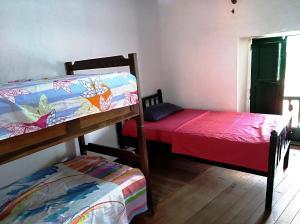 Voodi või voodid majutusasutuse Hostal Nomadas toas