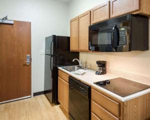 A kitchen or kitchenette at Suburban Extended Stay Hotel Morgantown