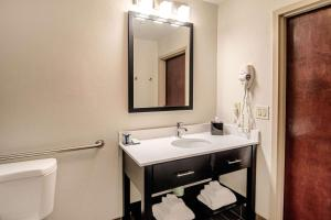 A bathroom at Sleep Inn & Suites Rehoboth Beach