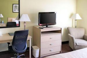 A television and/or entertainment center at Rodeway Inn Gloucester City