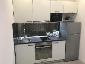Кухня или мини-кухня в Святобор LUX Apartments