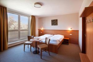 Postel nebo postele na pokoji v ubytování Penzion Ruland