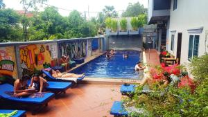 The swimming pool at or near Siem Reap Pub Hostel