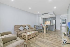 A seating area at Kozy Olympic Park 2Bed APT + FREE PARKING