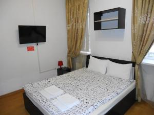 Кровать или кровати в номере Апарт Отель Доброславия