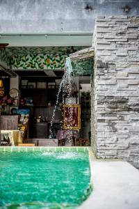 The swimming pool at or near Chedi Home