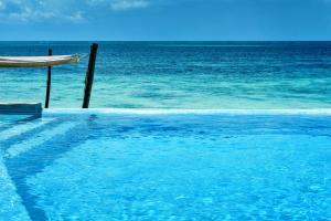 The swimming pool at or near Marafiki Bungalows