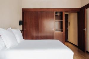 מיטה או מיטות בחדר ב-Hotel Derby