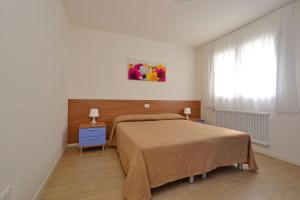 A bed or beds in a room at Bellarosa