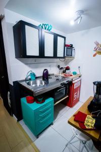 A kitchen or kitchenette at Meu lugar na Cidade Baixa