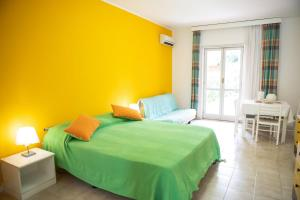 Letto o letti in una camera di Portorosa Residence