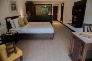 A bed or beds in a room at Hotel Sunderban Resort & Spa