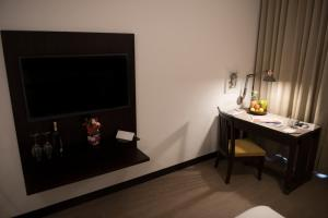 A television and/or entertainment centre at Hotel Sunderban Resort & Spa