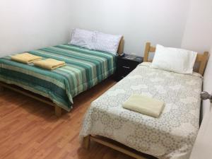 A bed or beds in a room at Hospedaje de los Reyes