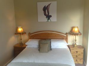 A bed or beds in a room at deBarra Lodge