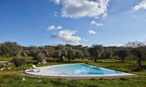 The swimming pool at or near Casas Caiadas | Boutique Home