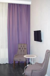 A seating area at Nice Hotel