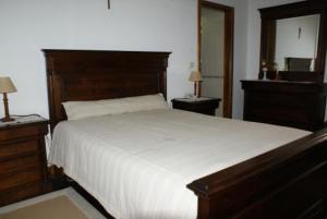 A bed or beds in a room at Quinta de S. Bento de Prado