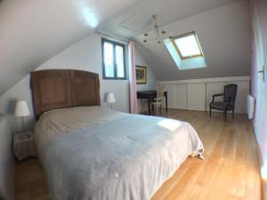 Un ou plusieurs lits dans un hébergement de l'établissement Le Gîte du Château