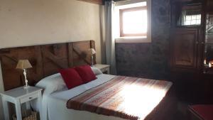 A bed or beds in a room at Estancia Los Plátanos
