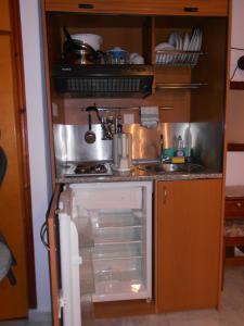 Η κουζίνα ή μικρή κουζίνα στο Zorbas Hotel & Studios