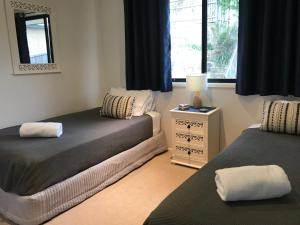 A bed or beds in a room at Avalon Seashells 2 Bedroom apartment with pool