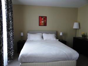 Un ou plusieurs lits dans un hébergement de l'établissement Villa Montmartre