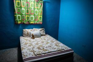 A bed or beds in a room at Ciao Cacao Hostel & Vegan Cafe