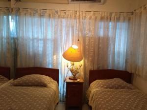 Cama o camas de una habitación en Casa Adriana VIP Backpackers