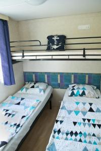 A bed or beds in a room at Mobilehome Primošten | Camp Adriatic