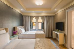 A bed or beds in a room at Rixos Premium Saadiyat Island – Ultra All Inclusive