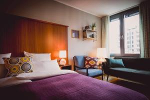 Ein Bett oder Betten in einem Zimmer der Unterkunft Henri Hotel Düsseldorf Downtown