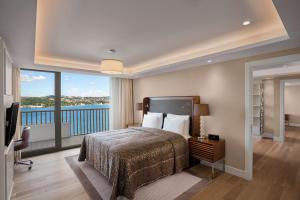 A bed or beds in a room at The Grand Tarabya Hotel