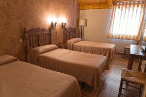 A bed or beds in a room at Hotel-Restaurante La Sima