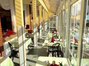 Ein Restaurant oder anderes Speiselokal in der Unterkunft Hotel Rodebachmühle